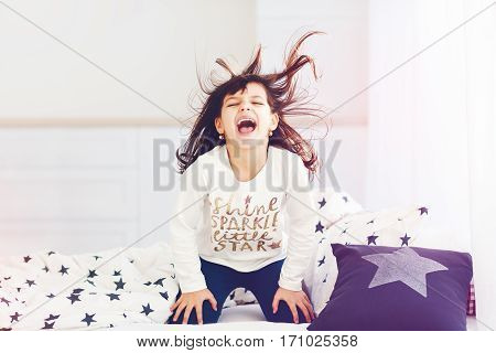 Vigorous Young Girl Singing In Bed In The Morning Sun Light