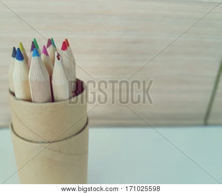 Pencils in a box with one broken pencil,A broken colored pencil tip,Broken Pencil with Snapped Pencil Tip Team Stress or Group Mistake Concept,Valentine fail concept.