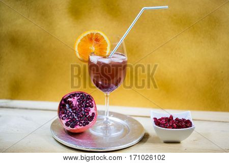 Pomegranate spray (pomegranate spritz ) on golden background