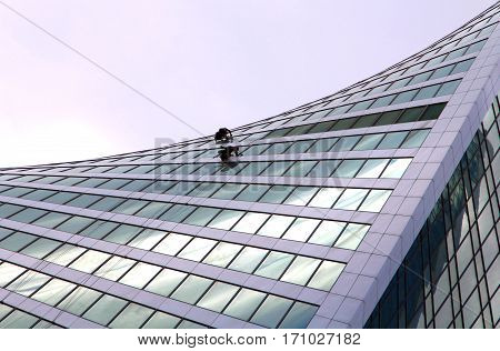 Window washers at a modern city skyscraper