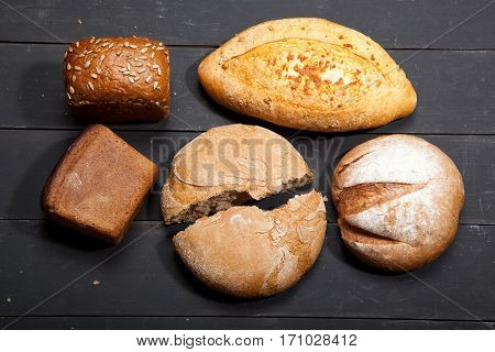 Homemade bread on a black wooden background