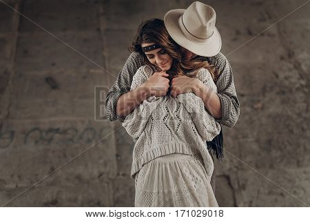 Handsome Stylish Cowboy Man In Hat And Shirt Embracing Beautiful Gypsu Woman From Behind, Sensual Co