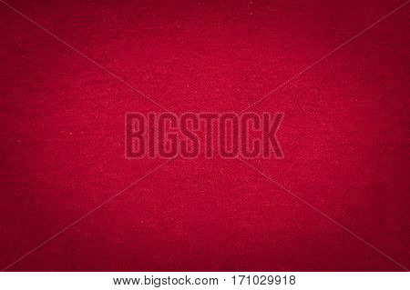 Red cloth texture with black gradient vignette christmas and valentine concept background with copy space