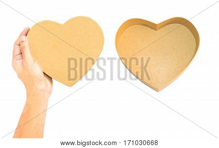 Hand hold Brown Heart paper box lid and empty opened heart box gift or preset box concept in christmas and happy new year holiday isolation on white with clipping path