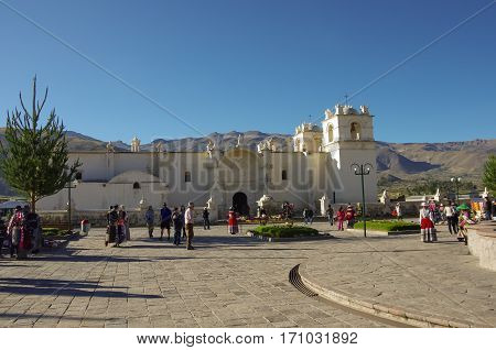 Yanque, Peru - January 2, 2014: Main square and Church of the Immaculate Conception with mountains behind in Yanque Colca Canyon Peru. .