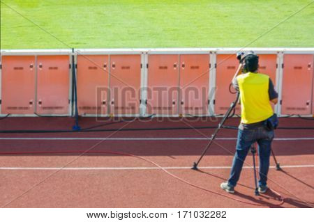 Defocused Of Cameraman Shooting Live Broadcast Soccer Match