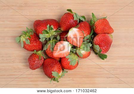 fresh organic strawberries on a cutting board