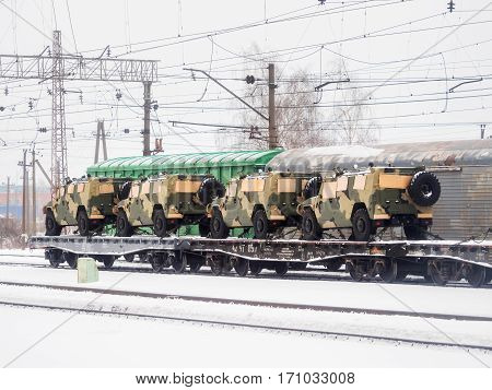 ODINTSOVO RUSSIA - January 22 2017. Transportation of military equipment. Multifunctional army car transported by train. Military utility vehicle.