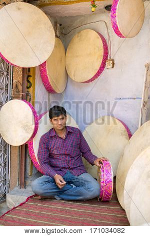 Jaisalmer, India - March 9, 2016: Traditional rajasthani frame drum shop in Jaisalmer, India.