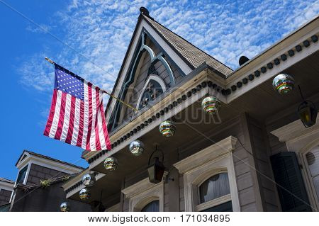 Detail of a colorful old house with the American Flag in the French Quarter in the city of New Orleans Louisiana.