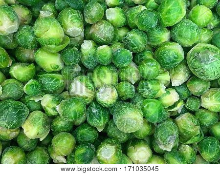 Vegetable background - Deep frozen green brussels sprouts closeup