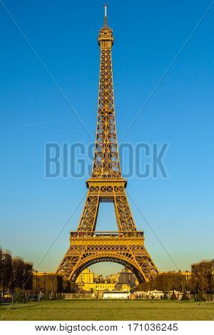 Eiffel Tower winter view from Champ de Mars in Paris, France.