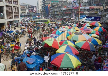 DHAKA, BANGLADESH - FEBRUARY 22, 2014: People do shopping at the Old market in Dhaka, Bangladesh. Dhaka is one of the most overpopulated cities in the world.