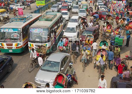 DHAKA, BANGLADESH - FEBRUARY 22, 2014: Traffic jam at the central part of the city in Dhaka, Bangladesh. Dhaka is one of the most overpopulated cities in the world.