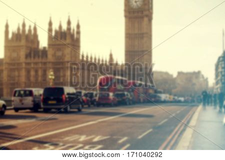 Big Ben in Westminster with red London Buses. Blurred background - retro styled photo