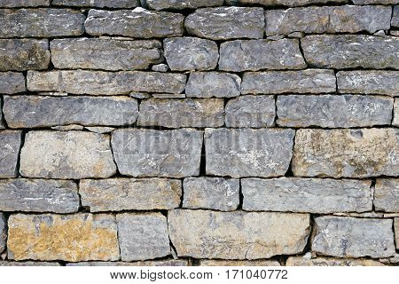 The texture of the stone wall exactly vilozheny stone blue-gray