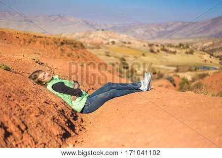 Girl was tired of thirst and lay down on the dry land