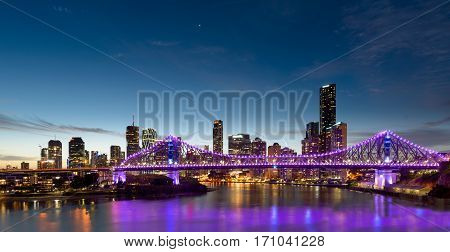 BRISBANE AUSTRALIA - NOVEMBER 19. 2016: The Story Bridage with with purple lights and downtown Brisbane in Australia.