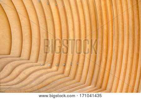 The wooden boards with an interesting bending were bonded parallel to each other