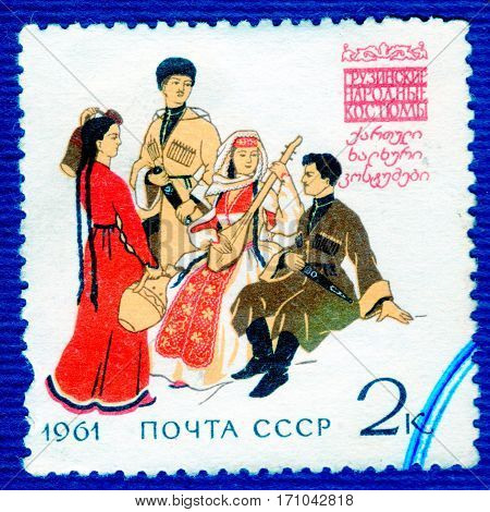 USSR - CIRCA 1961: Postage stamp printed in USSR shows image of musicians and dancers in Georgian traditional and historic folk costumes, from the series