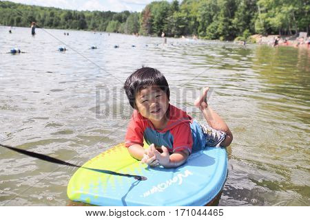 Child playing on body board at Bon Echo National Park in Ontario Canada