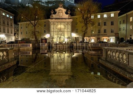 SALZBURG/ AUSTRIA - FEBRUARY 24. View of the old Horse Well at the Kapitelplatz Square at night on February 24, 2016 in Salzburg, Lower Austria.