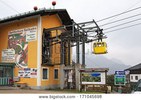 SANKT GILGEN/ AUSTRIA - FEBRUARY 25, 2016: Valley station of the Zwoelferhorn aerial tram during a snowfall in alpine village Sankt Gilgen, Austria.
