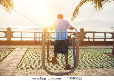 Man Doing Sports At The Sea's, Sunset