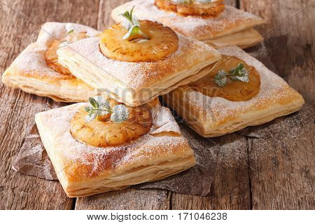 Sweet Puff Pastry Cake With Pineapple, Decorated With Mint Close-up On The Table. Horizontal