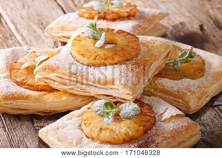 Freshly Baked Puff Pastry Pies With Pineapple Close-up. Horizontal