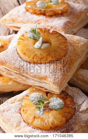 Freshly Baked Puff Pastry Pies With Pineapple Macro. Vertical