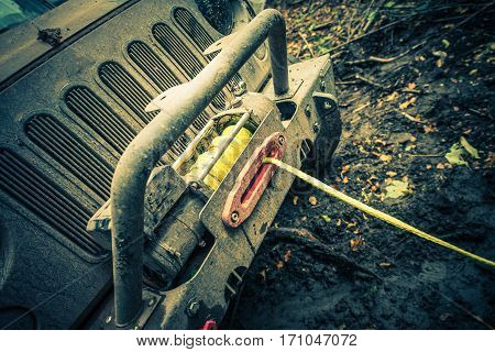 Offroad Car Recovery Winch. Recovering Vehicle From Deep Mud.