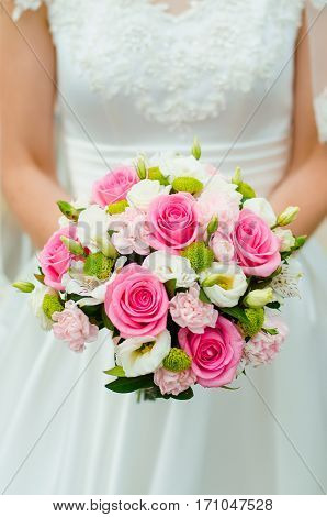 Bright bride's bouquet with pink roses and freesias