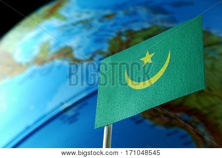 Mauritania Flag With A Globe Map As A Background Macro