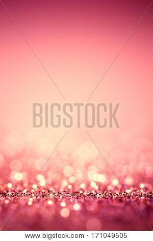 Defocused abstract pink glossy lights background - blurry bokeh lights
