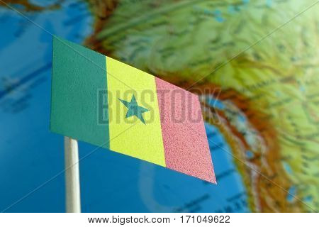 Senegal Flag With A Globe Map As A Background Macro
