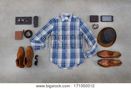 Men's casual outfits with accessories on gray