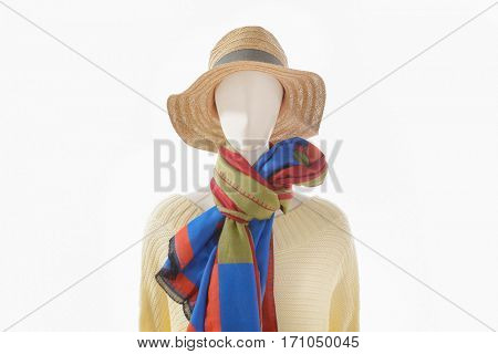 female sundress clothing with hat and colorful scarf on mannequin