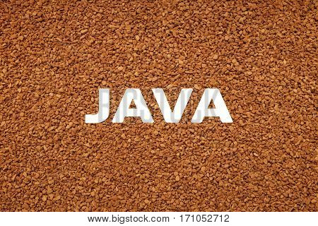Java Text Over Background Of Instant Coffee Granules