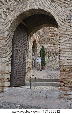MALAGA, SPAIN - DECEMBER 8, 2015: Arches at the Alcazaba a palatial fortification in Malaga, Spain