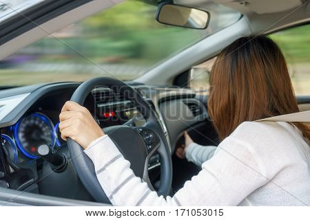 Young woman find something in drawer front of car with carelessness while driving - accident concept
