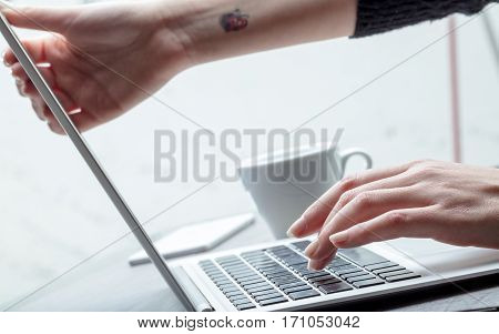 Businesswoman Adjusting Her Screen Height