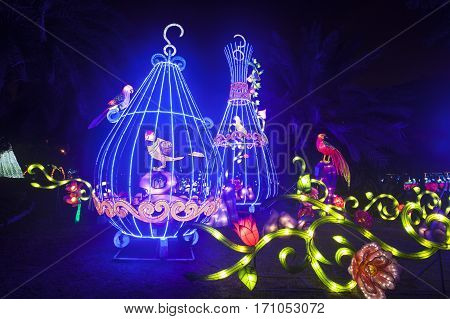 DUBAI UAE - DEC 6 2016: Beautiful installations at the Dubai Garden Glow family theme park illuminated at night. United Arab Emirates Middle East