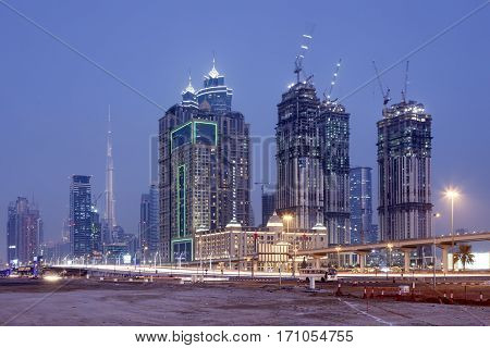 Skyscrapers in Dubai downtown illuminated at night. United Arab Emirates Middle East