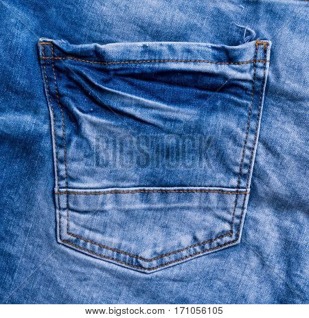 blue jeans rear pocket with tacks and seams, closeup