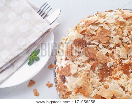 Multi layered cake with custard cream filling. Mille feuille. Puff pastry cake decorated with crumbs. Russian traditional Napoleon dessert with many layers. Top view. Horizontal.