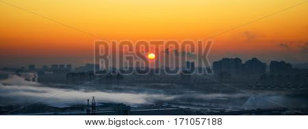 Industrial smog in the city at dawn and fog. Wide View
