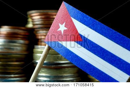 Cuba Flag Waving With Stack Of Money Coins Macro