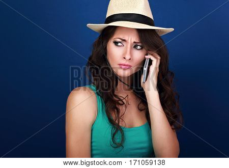 Gloomy Unhappy Frustration Woman In Summer Hat Talking On Mobile Phone And Listening The Bad News Wi
