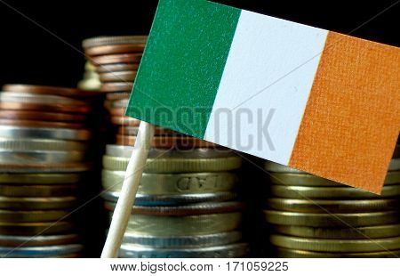 Ireland Flag Waving With Stack Of Money Coins Macro